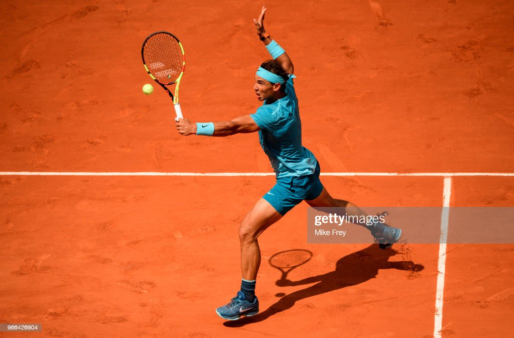 Rafael Nadal of Spain hits a backhand to Richard Gasquet of France in the third round of the men's singles on day seven of the French Open at Roland Garros on June 2, 2018 in Paris, France.
