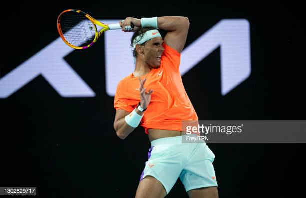 Rafael Nadal of Spain hits a forehand against Stefanos Tsitsipas of Greece during day 10 of the 2021 Australian Open at Melbourne Park on February...