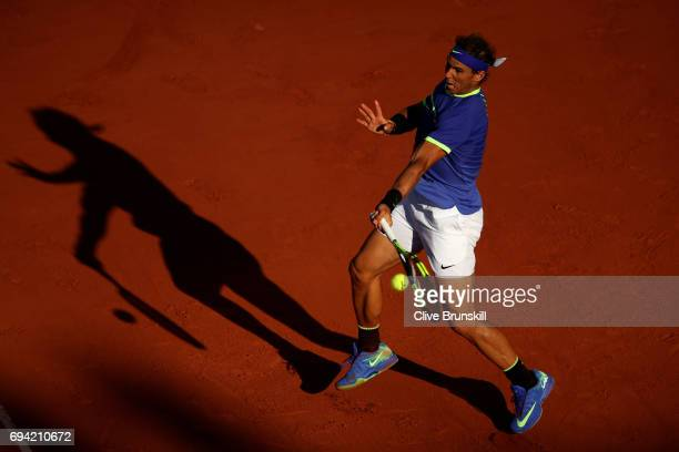 Rafael Nadal of Spain hits a forehand during the men's singles semi final match against Dominic Thiem of Austria on day thirteen of the 2017 French...