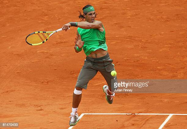 Rafael Nadal of Spain hits a forehand during the Men's Singles Semi Final match against Novak Djokovic of Serbia on day thirteen of the French Open...