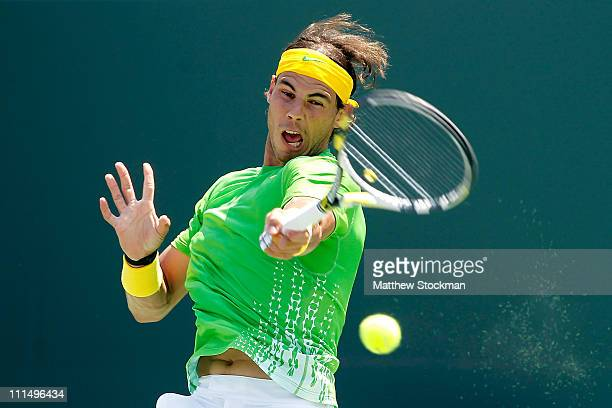 Rafael Nadal of Spain hits a forehand return against Novak Djokovic of Serbia during the men's singles championship at the Sony Ericsson Open at...