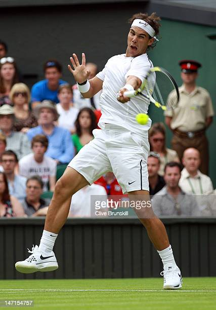 Rafael Nadal of Spain hits a forehand return during his Gentlemen's Singles first round match against Thomaz Bellucci of Brazil on day two of the...