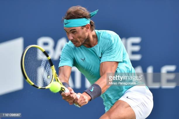 Rafael Nadal of Spain hits a return against Daniil Medvedev of Russia during the mens singles final on day 10 of the Rogers Cup at IGA Stadium on...