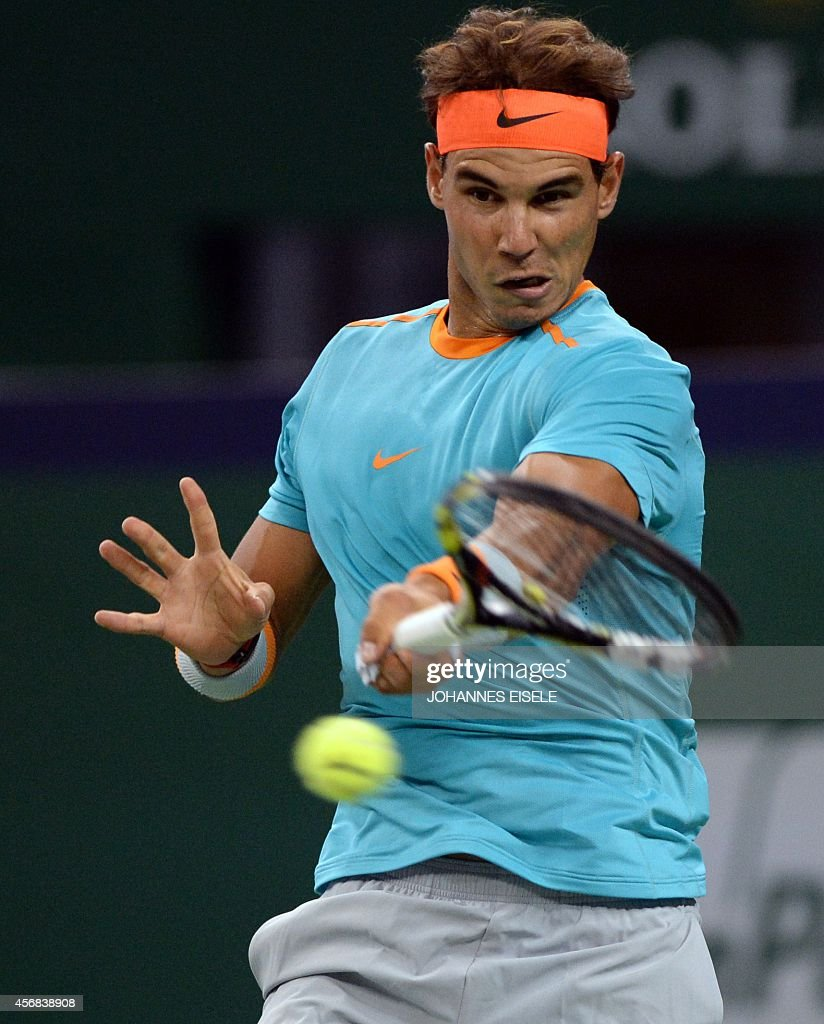Rafael Nadal of Spain hits a return against Feliciano Lopez of Spain during their men's singles second round match at the Shanghai Masters 1000 tennis tournament held in the Qizhong Tennis Stadium in Shanghai on October 8, 2014.