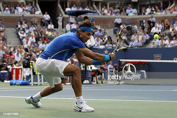 Rafael Nadal of Spain hits a return against Novak Djokovic of Serbia during the Men's Final on Day Fifteen of the 2011 US Open at the USTA Billie...