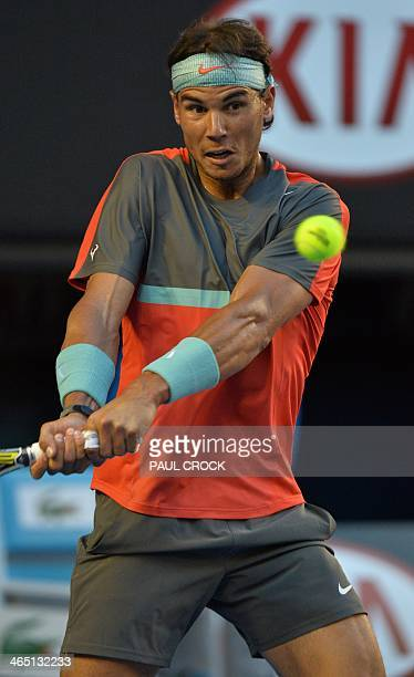 Rafael Nadal of Spain hits a return against Stanislas Wawrinka of Switzerland in the men's singles final on day 14 of the 2014 Australian Open tennis...