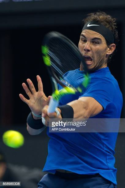 Rafael Nadal of Spain hits a return during his men's singles final match against Nick Kyrgios of Australia at the China Open tennis tournament in...