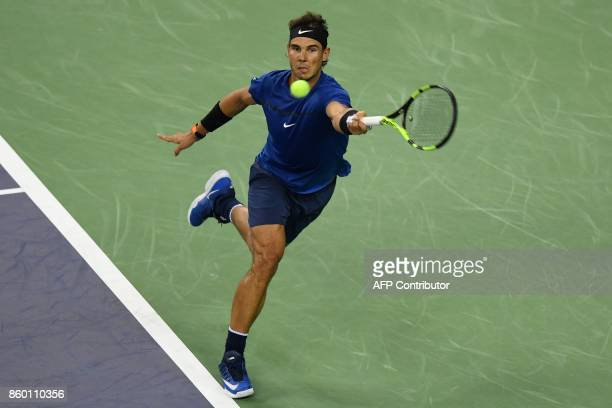 Rafael Nadal of Spain hits a return during the men's 2nd round singles match against Jared Donaldson of the US at the Shanghai Masters tennis...