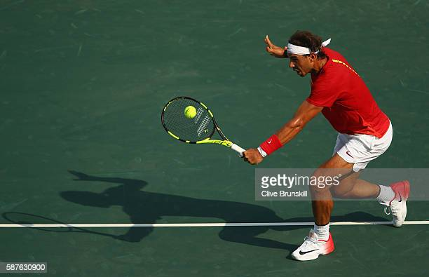 Rafael Nadal of Spain hits during the men's second round single match against Andreas Seppi of Italy on Day 4 of the Rio 2016 Olympic Games at the...