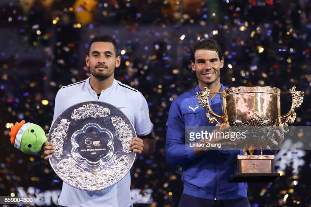 Rafael Nadal of Spain holding the winner's trophy with Nick Kyrgios of Australia poses for a picture after winning the Men's Singles final on day...