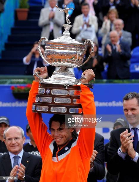 Rafael Nadal of Spain holds aloft the winners trophy after his match against his fellow countryman David Ferrer on day seven of the ATP 500 World...