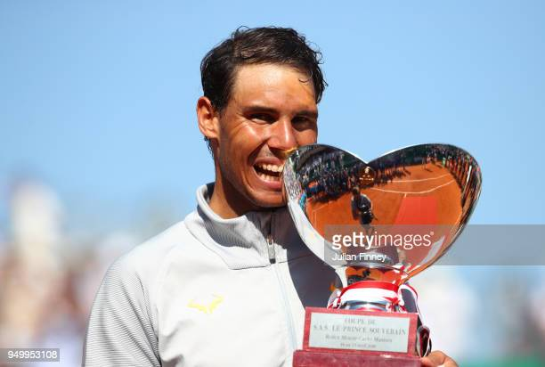 Rafael Nadal of Spain holds his winners trophy after winning the Monte Carlo Rolex Masters against Kei Nishikori of Japan during day eight of ATP...