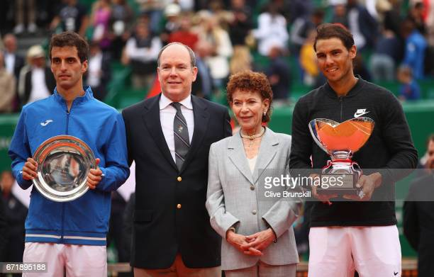 Rafael Nadal of Spain holds his winners trophy alongside Albert RamosVinolas of Spain Prince Albert ll of Monaco and Elisabeth Anne de Massy...