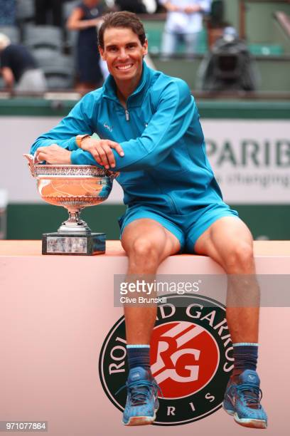 Rafael Nadal of Spain holds the Musketeers' Cup as he celebrates victory following the mens singles final against Dominic Thiem of Austria during day...