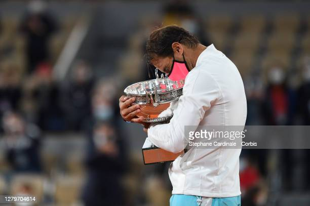Rafael Nadal of Spain holds the trophy after his victory against Novak Djokovic of Serbia in the Singles Final on Court Philippe-Chatrier during the...