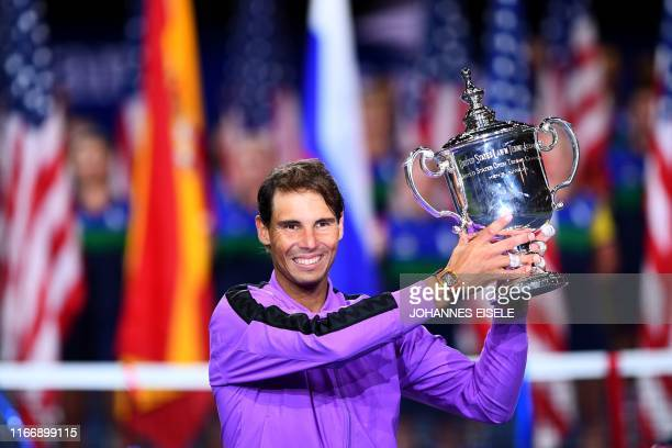 TOPSHOT Rafael Nadal of Spain holds the trophy after his win over Daniil Medvedev of Russia during the men's Singles Finals match at the 2019 US Open...