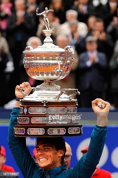 Rafael Nadal of Spain holds the trophy after winning his final match againts Nicolas Almagro of Spain during day seven of the 2013 Barcelona Open...