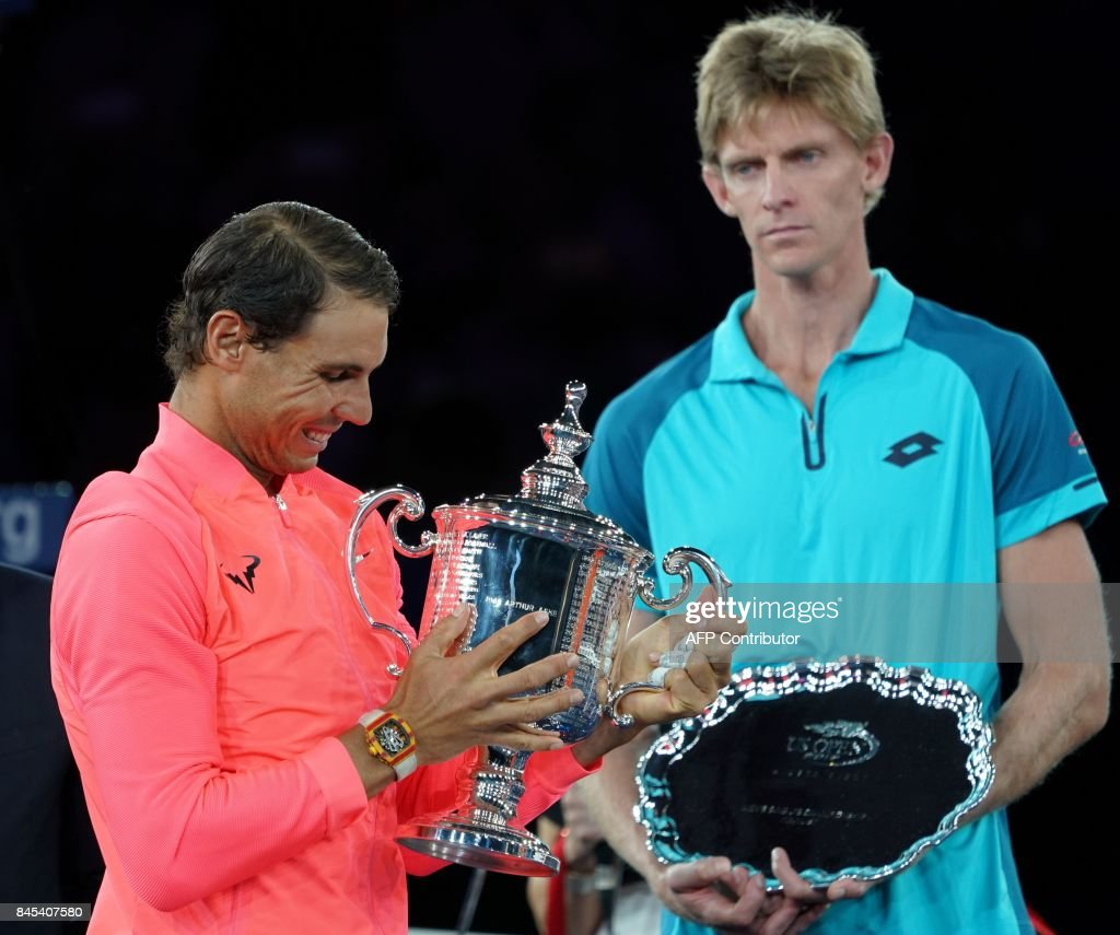 TOPSHOT - Rafael Nadal of Spain (L) holds the US Open trophy after defeating Kevin Anderson (R) of South Africa in their US Open Men's Singles Final match Septmber 10, 2017 at the Billie Jean King Stadium National Tennis Center in New York. /