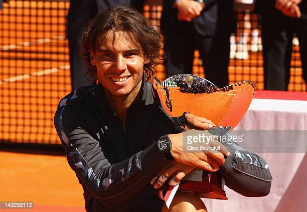 Rafael Nadal of Spain holds the winners trophy after his straight sets victory against Novak Djokovic of Serbia in the final during day eight of the...