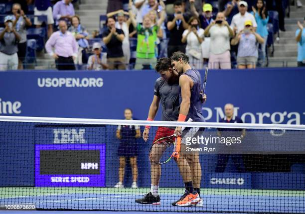 Rafael Nadal of Spain hugs Dominic Thiem of Austria after their men's singles quarterfinal match on Day Nine of the 2018 US Open at the USTA Billie...