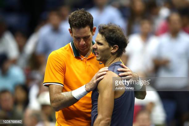 Rafael Nadal of Spain hugs Juan Martin del Potro of Argentina after he is forced to retire due to injury in his men's singles semifinal match on Day...