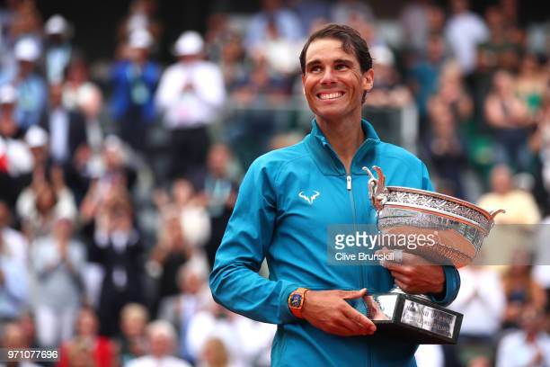 Rafael Nadal of Spain hugs the Musketeers' Cup as he celebrates victory following the mens singles final against Dominic Thiem of Austria during day...
