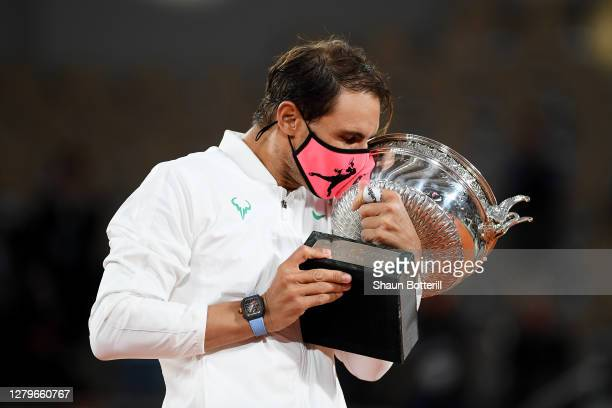Rafael Nadal of Spain hugs the winners trophy following victory in his Men's Singles Final against Novak Djokovic of Serbia on day fifteen of the...