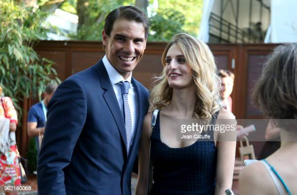 Rafael Nadal of Spain ice dance skating French champion Gabriella Papadakis following the draws of the 2018 French Open at Roland Garros stadium on...