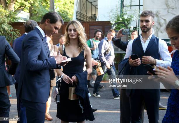 Rafael Nadal of Spain ice dance skating French champions Gabriella Papadakis and Guillaume Cizeron following the draws of the 2018 French Open at...