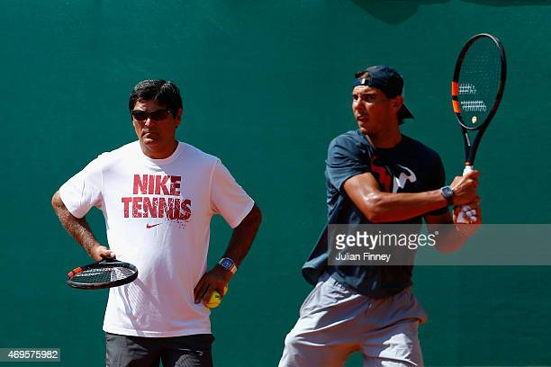 Rafael Nadal of Spain in a practice session as uncle and coach Toni Nadal watches on during day two of the Monte Carlo Rolex Masters tennis at the...