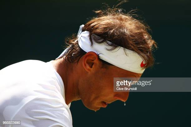 Rafael Nadal of Spain in action against Alex De Minaur of Australia during their Men's Singles third round match on day six of the Wimbledon Lawn...
