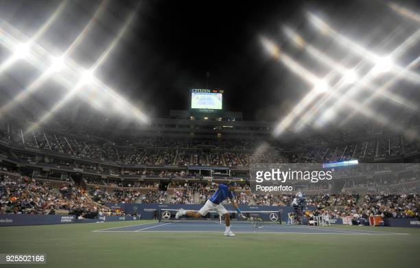 Rafael Nadal of Spain in action against Andy Murray of Great Britain under the floodlights during Day Thirteen of the 2011 US Open at the USTA Billie...