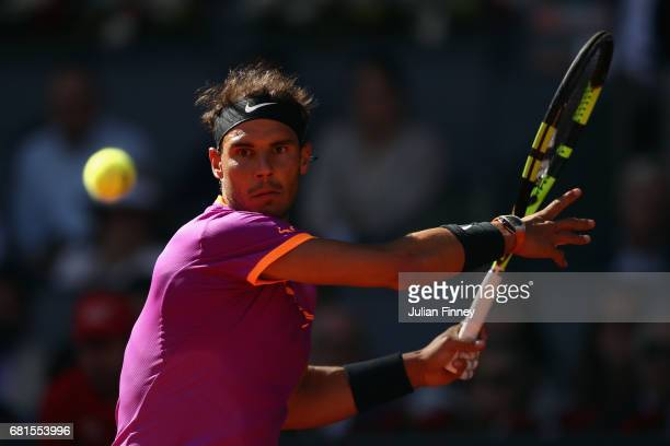 Rafael Nadal of Spain in action against Fabio Fognini of Italy during day five of the Mutua Madrid Open tennis at La Caja Magica on May 10 2017 in...