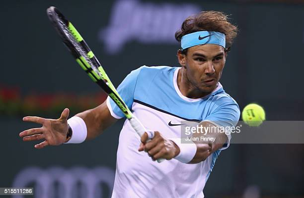 Rafael Nadal of Spain in action against Gilles Muller of Luxembourg during day seven of the BNP Paribas Open at Indian Wells Tennis Garden on March...