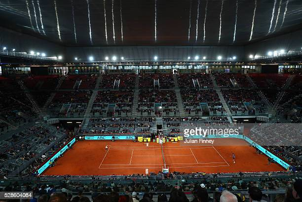 Rafael Nadal of Spain in action against Joao Sousa of Portugal under a closed roof during day seven of the Mutua Madrid Open tennis tournament at the...