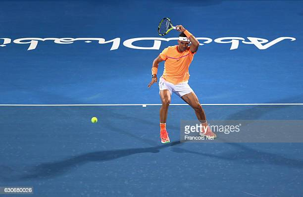 Rafael Nadal of Spain in action against Milos Raonic of Canada during day two of the Mubadala World Tennis Championship at Zayed Sport City on...