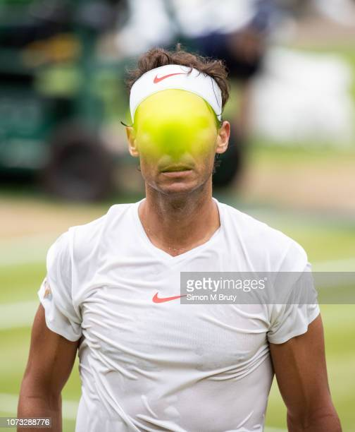 Rafael Nadal of Spain in action against Novak Djokovic of Serbia during The Wimbledon Lawn Tennis Championship at the All England Lawn Tennis and...