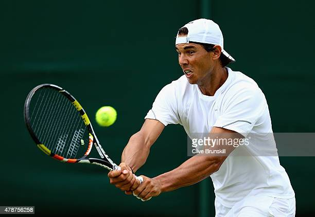 Rafael Nadal of Spain in action during a practice session prior to the Wimbledon Lawn Tennis Championships at the All England Lawn Tennis and Croquet...