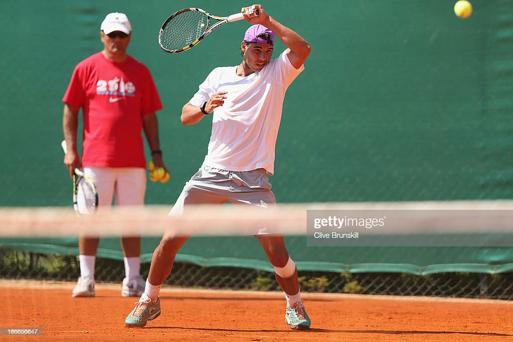 Rafael Nadal of Spain in action during a practice session watched by his coach Toni Nadal prior to his second round match during day two of the ATP Monte Carlo Masters,at Monte-Carlo Sporting Club on April 15, 2013 in Monte-Carlo, Monaco.
