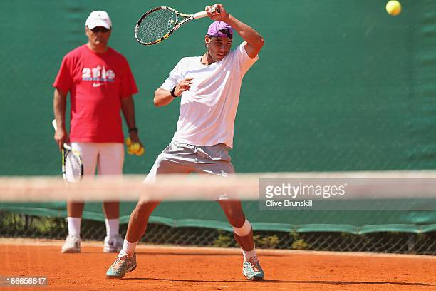 Rafael Nadal of Spain in action during a practice session watched by his coach Toni Nadal prior to his second round match during day two of the ATP...