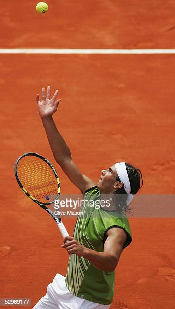 Rafael Nadal of Spain in action during his first round match against Lars Burgsmuller of Germany on the first day of the French Open at Roland Garros...