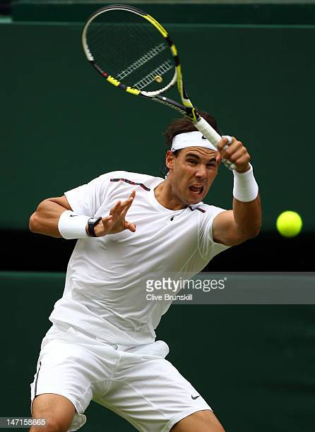 Rafael Nadal of Spain in action during his Gentlemen's Singles first round match against Thomaz Bellucci of Brazil on day two of the Wimbledon Lawn...