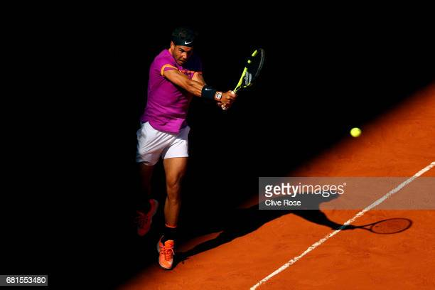 Rafael Nadal of Spain in action during his match against Fabio Fognini of Italy on day five of the Mutua Madrid Open tennis at La Caja Magica on May...