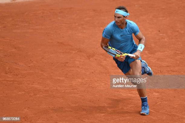 Rafael Nadal of Spain in action during his men's singles first round match against Simone Bolelli of Italy during day 3 of the 2018 French Open at...