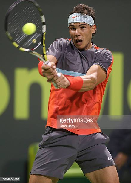 Rafael Nadal of Spain in action in his first round match against Lukas Rosol of Czech Republic during the Qatar ExxonMobil Open 2014 held at the...