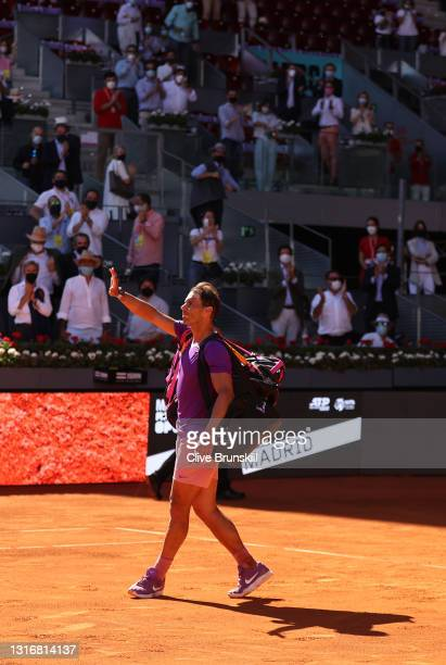 Rafael Nadal of Spain interacts with the crowd following their Quarter Final loss against Alexander Zverev of Germany during Day Nine of the Mutua...