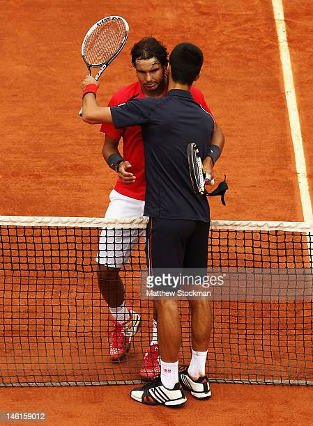 Rafael Nadal of Spain is congratulated by Novak Djokovic of Serbia after the men's singles final during day 16 of the French Open at Roland Garros on...