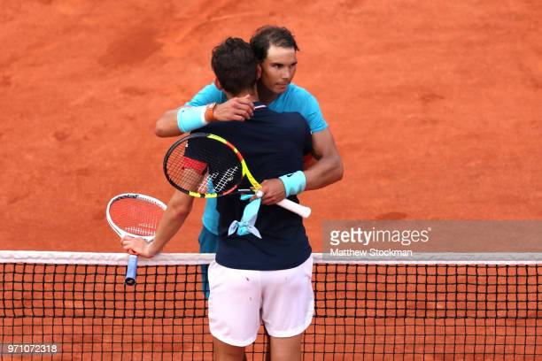 Rafael Nadal of Spain is congratulated on victory by Dominic Thiem of Austria following the mens singles final during day fifteen of the 2018 French...