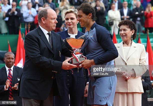 Rafael Nadal of Spain is presented with the trophy by Prince Albert II of Monaco Princess Charlene of Monaco and Elisabeth Anne de Massy after...