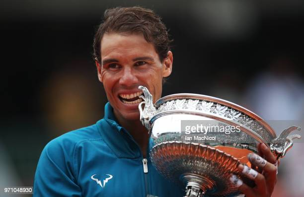 Rafael Nadal of Spain is seen with the trophy after his Men's Singles Final match against Dominic Thiem of Austria during day fiftteen of the 2018...
